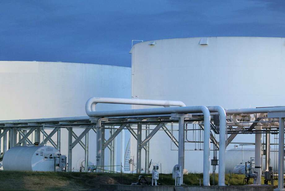 In this photo taken Monday, July 2, 2012, early morning sunlight illuminates fuel storage tanks at a North Little Rock, Ark., petroleum distributorship. The price of oil fell Monday, Aug. 27, 2012, as the threat to production from Tropical Storm Isaac appeared to lessen and traders speculated about a release of oil from U.S. reserves. (AP Photo/Danny Johnston) Photo: AP, STF / AP