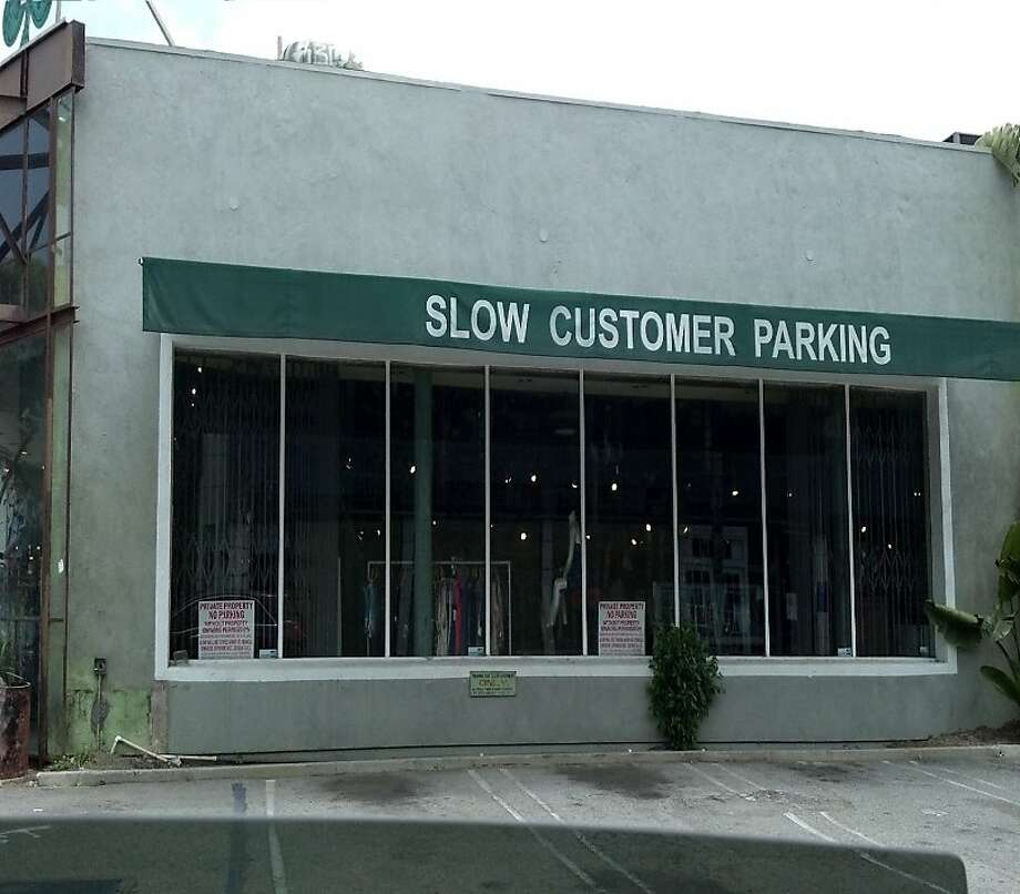 Slow customers receive the VIP treatment at this Los Angeles store, with parking set aside for them. Fast customers: Better start scouting spaces. Photo: Solder Fish, Signspotting.com