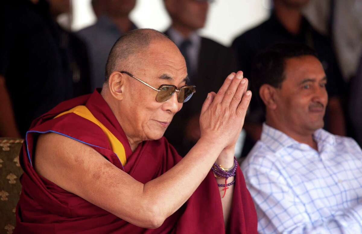Tibetan spiritual leader the Dalai Lama greets the crowd gathered for a function at the Tibetan school in Srinagar, India, Saturday, July 14, 2012. The Dalai Lama is on a four-day visit to the troubled portion of Indian Kashmir. (AP Photo/ Dar Yasin)