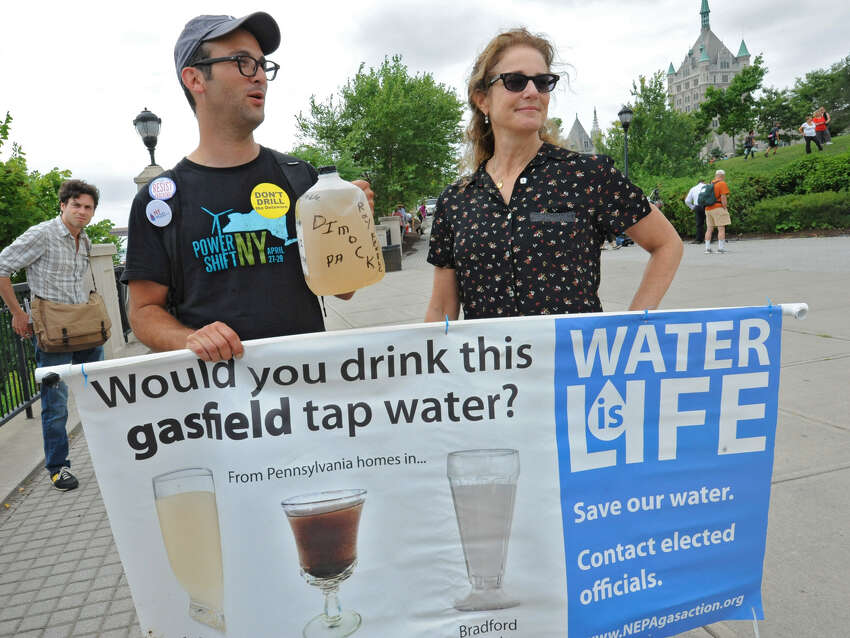 Filmmaker Josh Fox stands with actress Debra Winger while participating in an anti-fracking rally Monday at the Corning Preserve in Albany. (Lori Van Buren / Times Union)