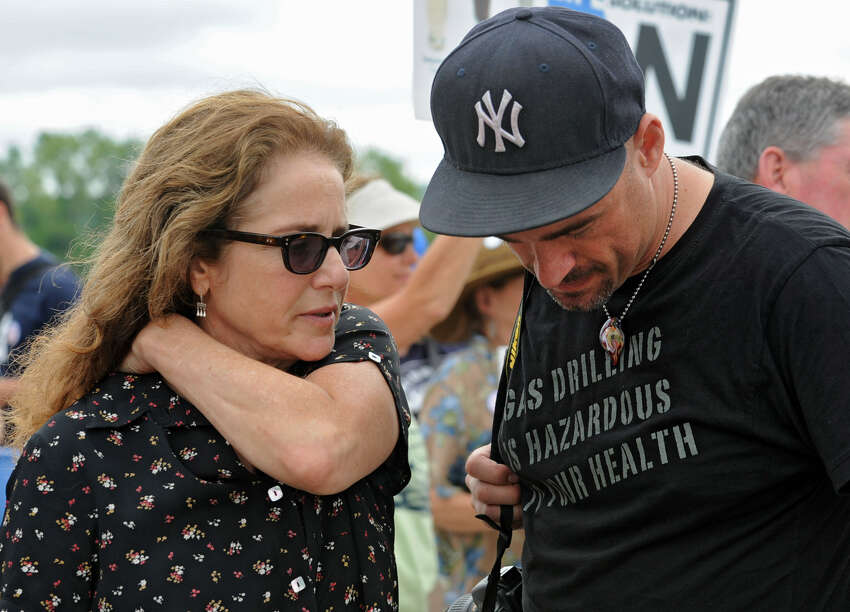 Actress Debra Winger talks to David Braun, of United for Action and New Yorkers Against Fracking, as they participate in an anti-fracking rally Monday at the Corning Preserve in Albany. (Lori Van Buren / Times Union)