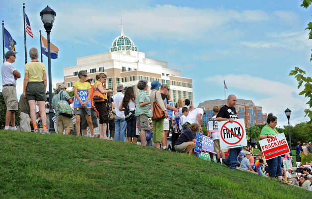 Hundreds of people show up Monday for an anti-fracking rally at the Corning Preserve in Albany. The DEC building, which protesters later marched to, is seen in the background. (Lori Van Buren / Times Union) Photo: Lori Van Buren