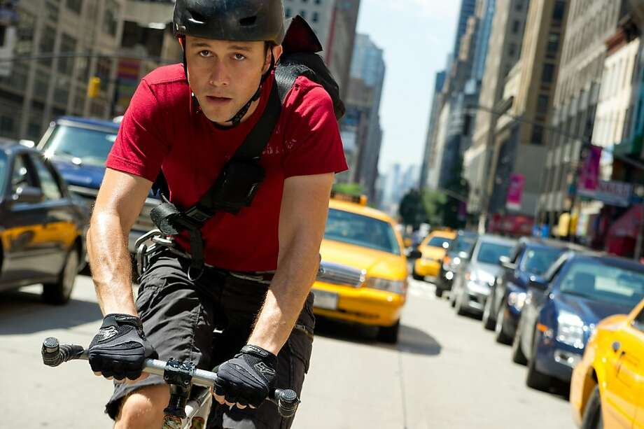 "Joseph Gordon-Levitt stars as a bicycle messenger who is chased by a crazy cop in ""Premium Rush."" Photo: Sarah Shatz, Associated Press"