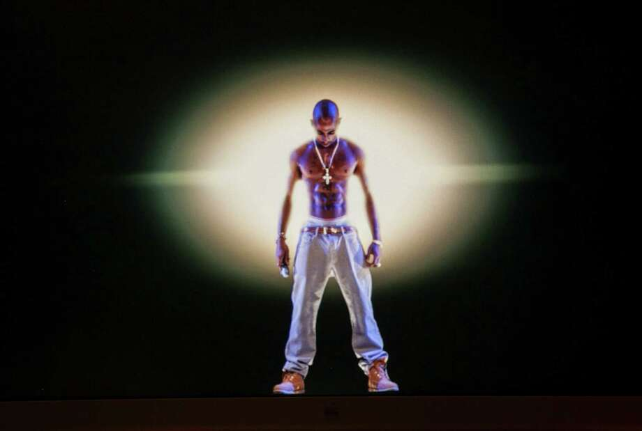 The inclusion of a Tupac Shakur hologram at a California concert may usher in a new form of live entertainment. But there are legal considerations. Photo: Damian Dovarganes, Associated Press / AP
