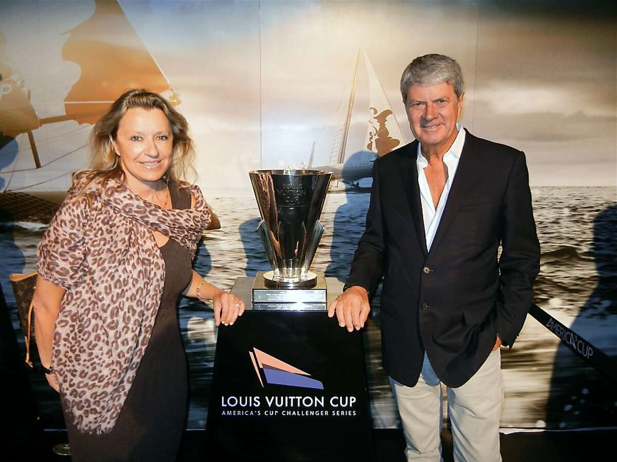 Louis Vuitton Events director Christine Belanger and outgoing CEO Yves Carcelle at America's Cup Club 45. August 2012.