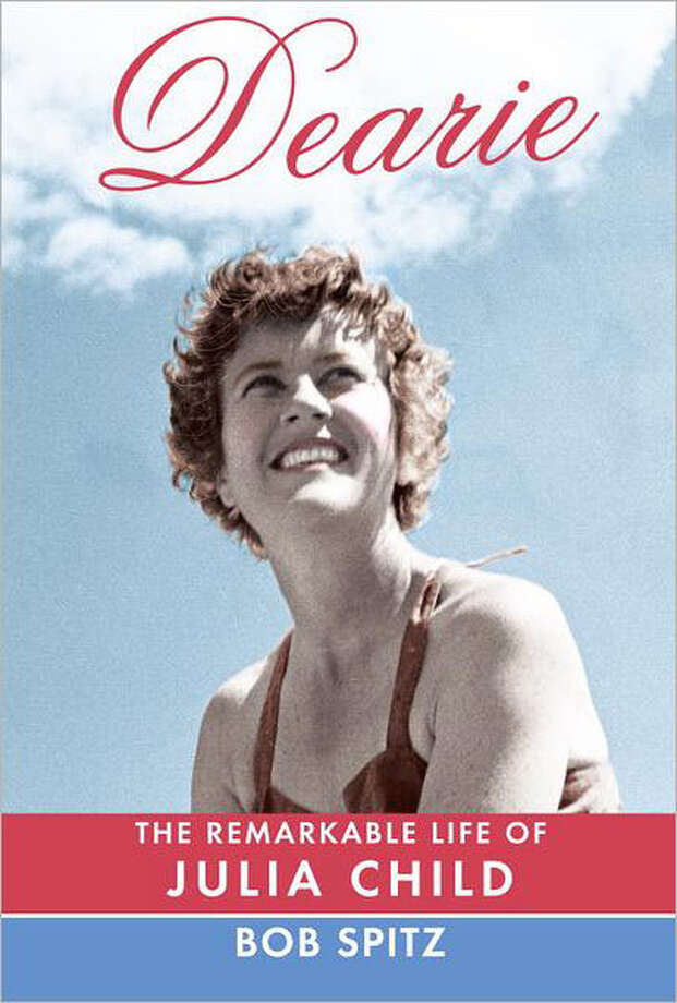 "Julia Child made her TV cooking debut in 1962, in black and white, and by the time she'd finished making an omelet, audiences were hooked. TV cooking has never been the same. Now, out in time for what would have been the late chef's 100th birthday on Aug. 15, Bob Spitz has written a soup-to-nuts biography of her life titled ""Dearie: The Remarkable Life of Julia Child."""