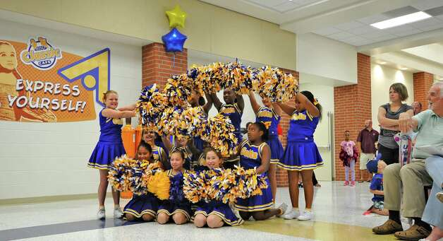 The Curtis Colts cheerleading squad did several routines for the crowd. Sallie Curtis Elementary School had its grand opening and official dedication Friday August 24, 2012.  BISD officials, school board trustees, students, teachers and staff were all on hand to help cut the ribbon and then tour the last of the new schools to be built with bond money.   Dave Ryan/The Enterprise Photo: Dave Ryan