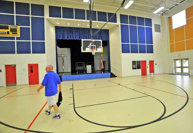 Coach Michael Thaxton walks through his new gym heading to the office. Sallie Curtis Elementary School had its grand opening and official dedication Friday August 24, 2012.  BISD officials, school board trustees, students, teachers and staff were all on hand to help cut the ribbon and then tour the last of the new schools to be built with bond money.   Dave Ryan/The Enterprise Photo: Dave Ryan