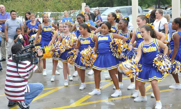As ceremonies commenced, the Curtis Colts cheerleading squad did several routines for the crowd. Sallie Curtis Elementary School had its grand opening and official dedication Friday August 24, 2012.  BISD officials, school board trustees, students, teachers and staff were all on hand to help cut the ribbon and then tour the last of the new schools to be built with bond money.   Dave Ryan/The Enterprise Photo: Dave Ryan