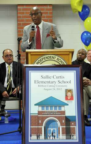 Superintendent Carrol Thomas addresses the crowd. Sallie Curtis Elementary School had its grand opening and official dedication Friday August 24, 2012.  BISD officials, school board trustees, students, teachers and staff were all on hand to help cut the ribbon and then tour the last of the new schools to be built with bond money.   Dave Ryan/The Enterprise Photo: Dave Ryan