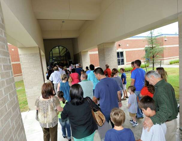 Guests enter the new school for inside ceremonies and an open house. Sallie Curtis Elementary School had its grand opening and official dedication Friday August 24, 2012.  BISD officials, school board trustees, students, teachers and staff were all on hand to help cut the ribbon and then tour the last of the new schools to be built with bond money.   Dave Ryan/The Enterprise Photo: Dave Ryan