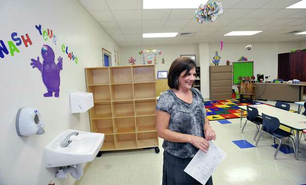 Kindergarden teacher Colleen Leviner, center, talks about her new classroom. Sallie Curtis Elementary School had its grand opening and official dedication Friday August 24, 2012.  BISD officials, school board trustees, students, teachers and staff were all on hand to help cut the ribbon and then tour the last of the new schools to be built with bond money.   Dave Ryan/The Enterprise Photo: Dave Ryan