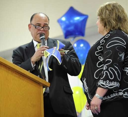 Principal Susan Brown, right, accepts the key to the school officially from BISD Board President Woodrow Reece.  Sallie Curtis Elementary School had its grand opening and official dedication Friday August 24, 2012.  BISD officials, school board trustees, students, teachers and staff were all on hand to help cut the ribbon and then tour the last of the new schools to be built with bond money.   Dave Ryan/The Enterprise Photo: Dave Ryan