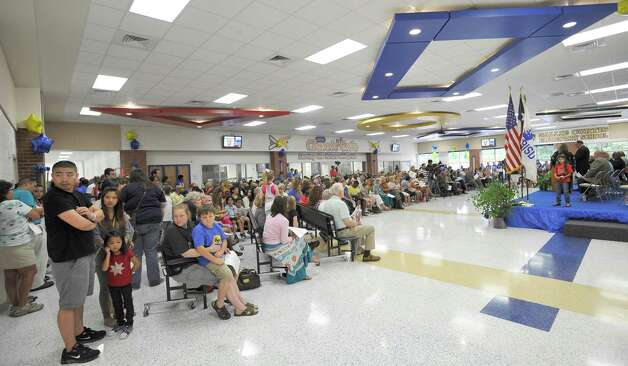 The new cafeteria  had standing room only by the time ceremonies commenced. Sallie Curtis Elementary School had its grand opening and official dedication Friday August 24, 2012.  BISD officials, school board trustees, students, teachers and staff were all on hand to help cut the ribbon and then tour the last of the new schools to be built with bond money.   Dave Ryan/The Enterprise Photo: Dave Ryan