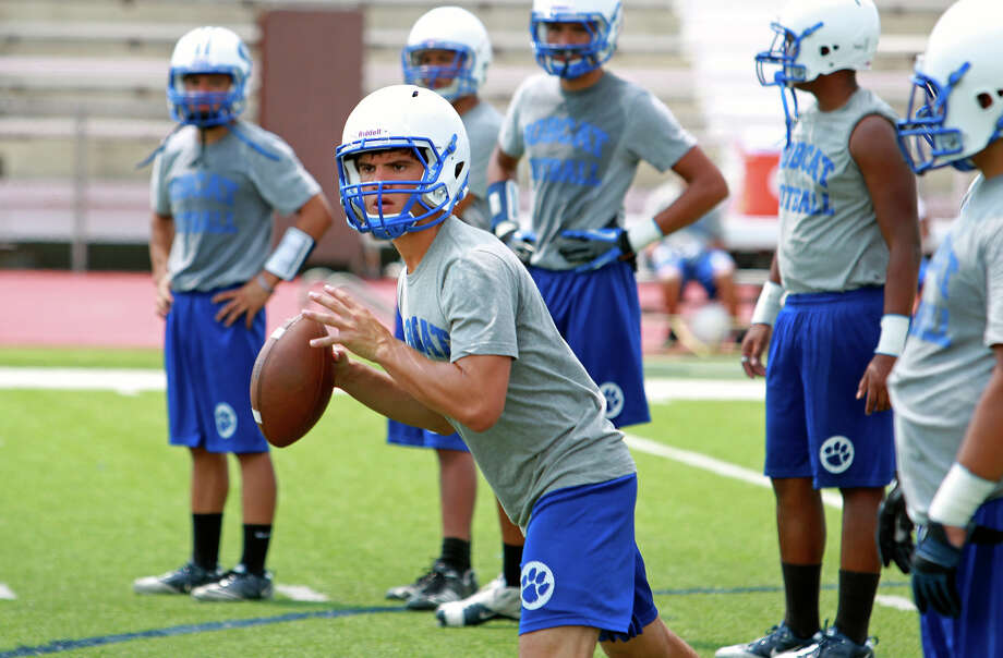 Quarterback Justin Martinez looks to his left in practice as the South San Bobcats go through drills under new head coach Marcus Booker  on August 22, 2012. Photo: Tom Reel, San Antonio Express-News / ©2012 San Antono Express-News