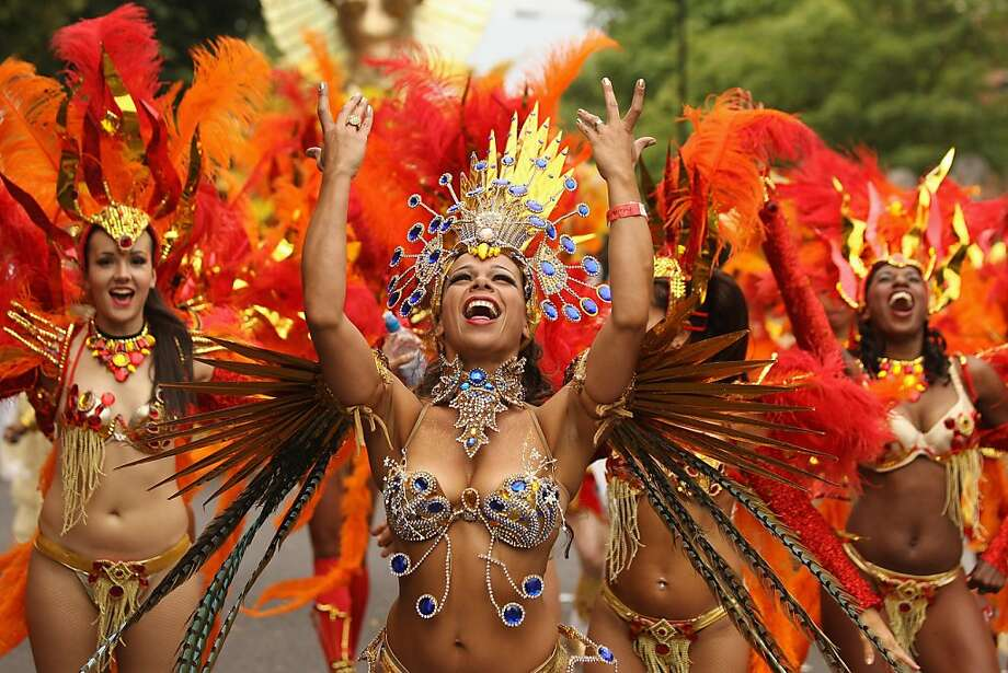 Thank goodness!Fortunately, the high in London was 74 Tuesday, so there was little danger of the Notting Hill Carnival's underdressed performers catching cold. Photo: Oli Scarff, Getty Images