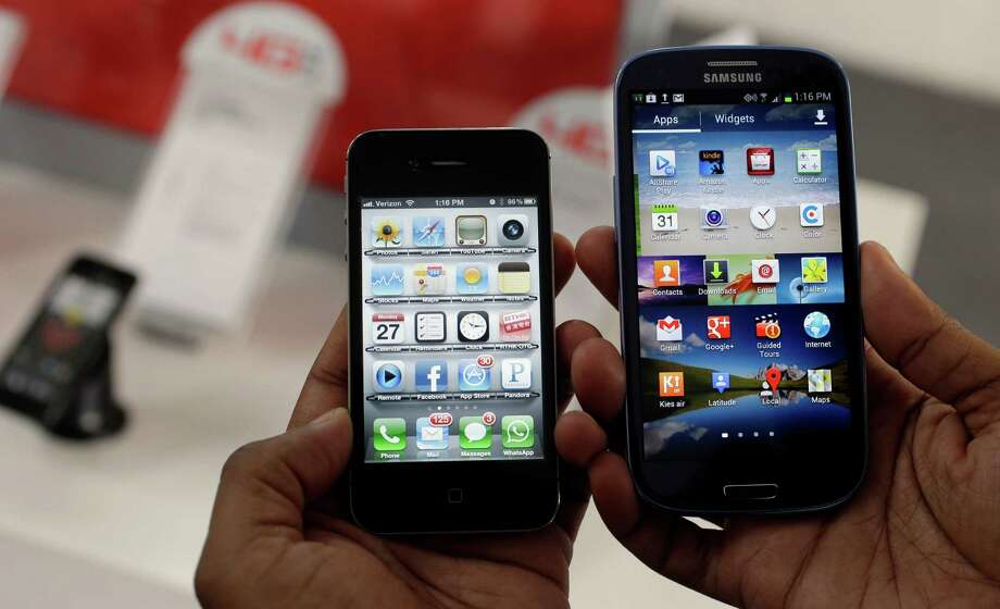 The Apple iPhone 4s, left, is displayed next to the Samsung Galaxy S III at a store in San Francisco, Monday, Aug. 27, 2012. Apple Inc. on Monday submitted a list of eight Samsung Electronics Co. products it wants pulled from shelves and banned from the U.S. market. Apple submitted the list after a jury found Samsung copied the iPhone and iPad in creating and marketing the products. (AP Photo/Marcio Jose Sanchez) Photo: Marcio Jose Sanchez, Associated Press / AP