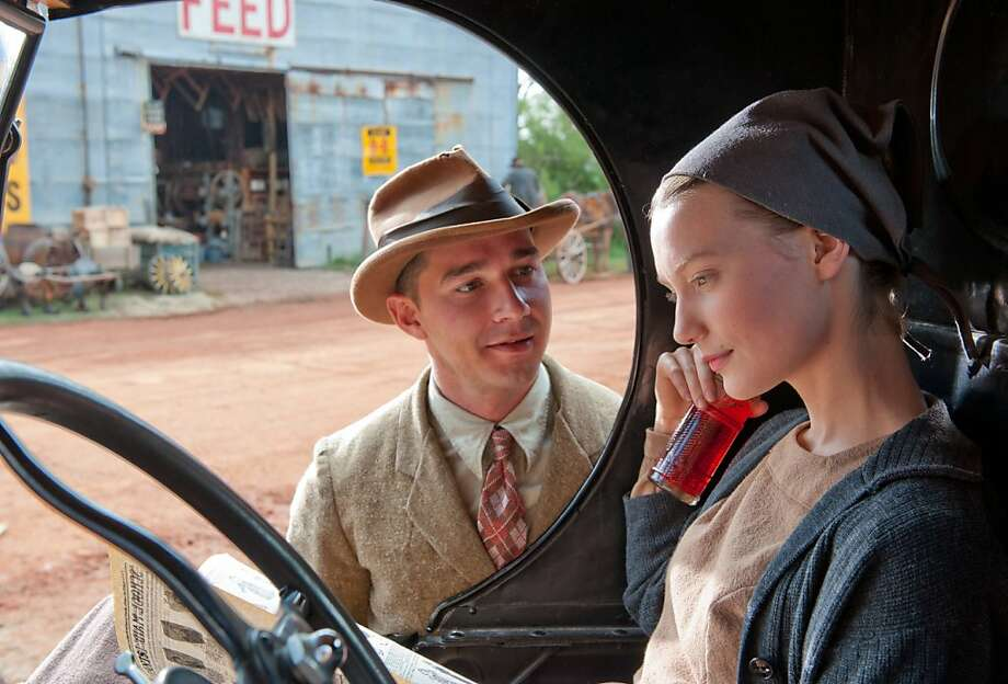 "Jack (Shia LaBeouf) tries to woo Bertha (Mia Wasikowska) in the bootlegging drama ""Lawless."" Photo: Richard Foreman, Jr., Associated Press"