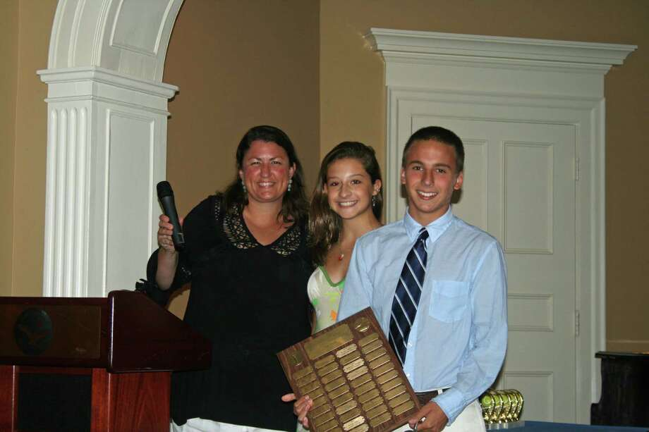 Westport's Tanner Blank, right, of the Norwalk-based Shorehaven Golf Club swim team, accepts the Clark Falkenstein Diving Award and the Shorehaven Golf Club MVP award at the team's banquet earlier this month. Also pictured are, far left, head coach Shannon Eagen, and assistant coach Olivia Piazza. Photo: Contributed Photo