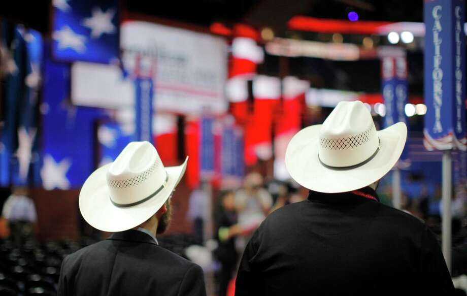 Jeremy Blosser and Chris Howe, both from Fort Worth, arrive on the floor at the Republican National Convention in Tampa on Monday. Photo: Charles Dharapak, Associated Press / AP
