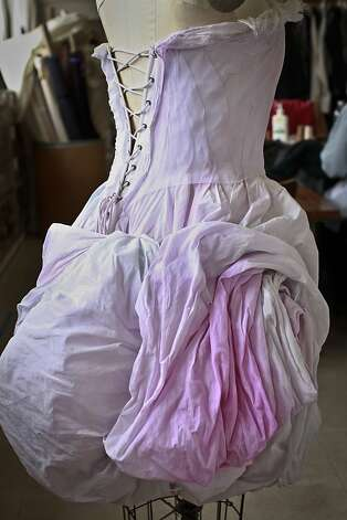 The pink dress sketch come to life at the San Francisco Opera's costume shop. Photo: Russell Yip, The Chronicle