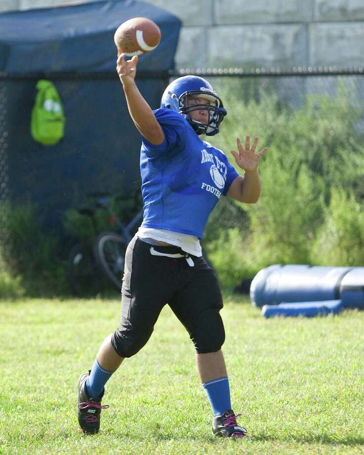 Abott Tech quarterback Greg Ramos fires a pass during practice Monday at Abbott Tech. Photo: Barry Horn / The News-Times Freelance