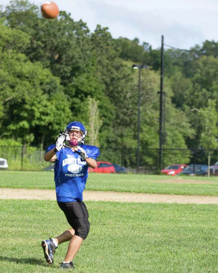 Abbott Tech's Dustin Belmonte grabs a pass during practice Monday at Abbott Tech. Photo: Barry Horn