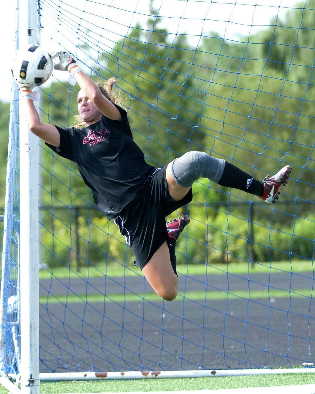 Immaculate goalkeeper Ashley Houghton makes a save during Monday's practice at Immaculate High School.