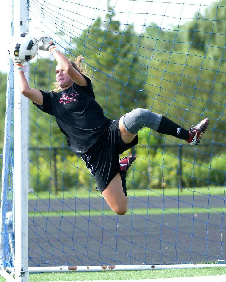 Immaculate goalkeeper Ashley Houghton makes a save during Monday's practice at Immaculate High School. Photo: Barry Horn / The News-Times Freelance