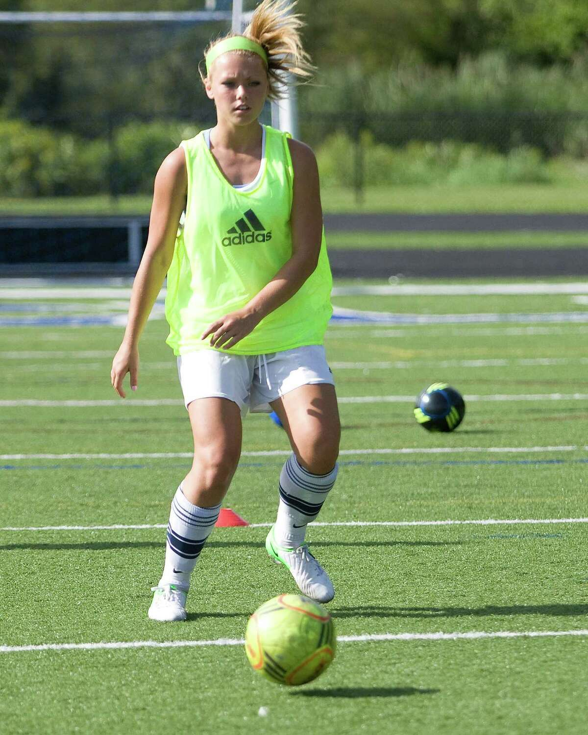 Immaculate's Lindsey Josseck works on a passing drill during practice Monday at Immaculate High School.