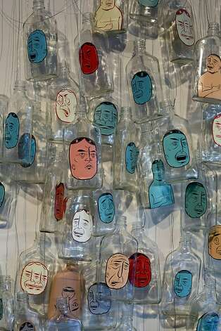 """Untitled"" (2005), acrylic on glass bottles with wire, by Barry McGee. Photo: Colin M. Day"