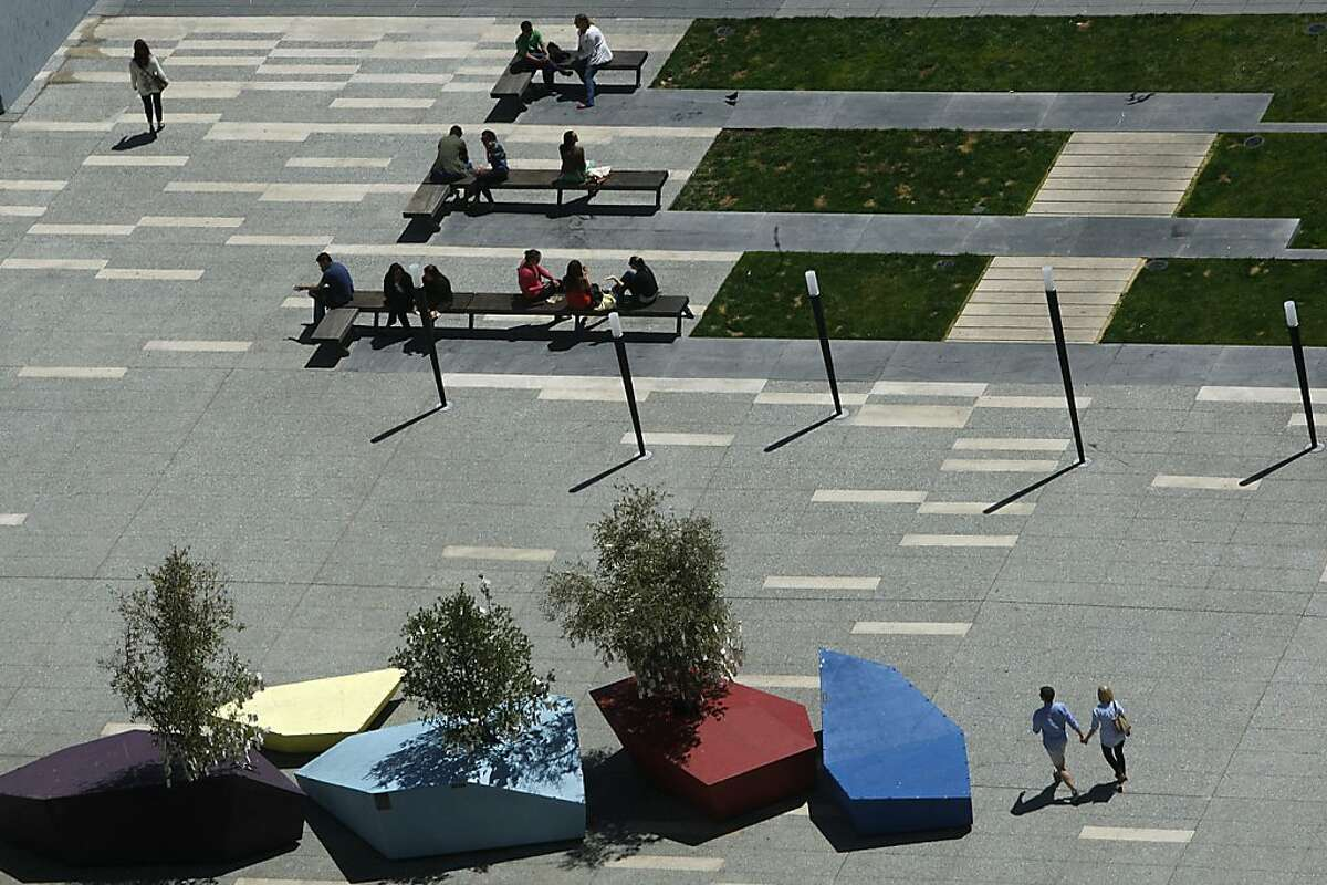 A group of gem-shaped islands is an installation called Nomadic Grove, 2012, wood planter and oak trees, made by a San Francisco-based art and design studio, Rebar, in Jessie Square in San Francisco, Calif., seen during early Friday afternoon, on August 24, 2012.