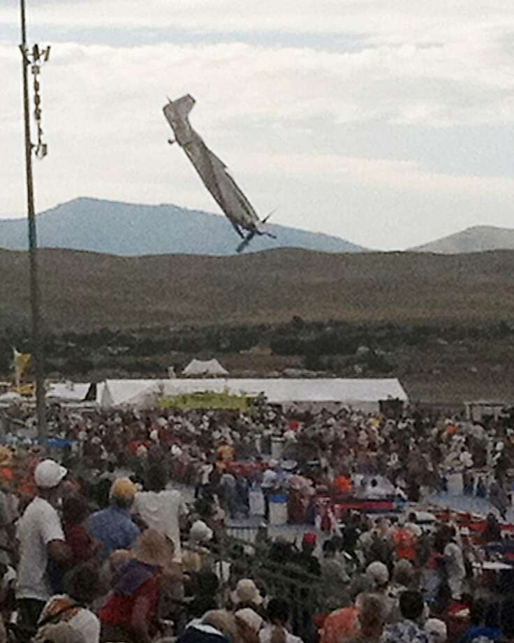 A World War II-era P-51 Mustang airplane piloted by Jimmy Leeward plummets toward the ground last year at the Reno National Championship Air Races. The crash killed the pilot and 10 spectators and injured 60 others. Photo: Garret Woodman, Associated Press