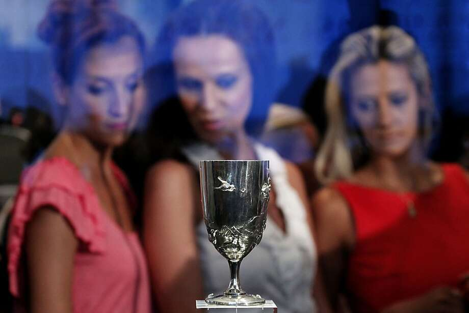 A silver cup won at the first modern Olympic Games, in Athens in 1896, by marathon runner Spyros Louis, is on display at the Acropolis Museum, on Monday, Aug. 27, 2012.  The cup, recently sold by the Greek athlete's descendants, was bought by a private Greek foundation at an auction in London. (AP Photo/Petros Giannakouris) Photo: Petros Giannakouris, Associated Press