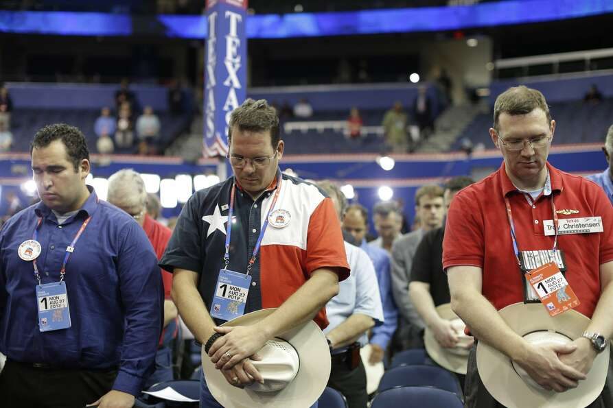 Delegates from Texas pray during an abbreviated session of the Republican National Convention in Tam