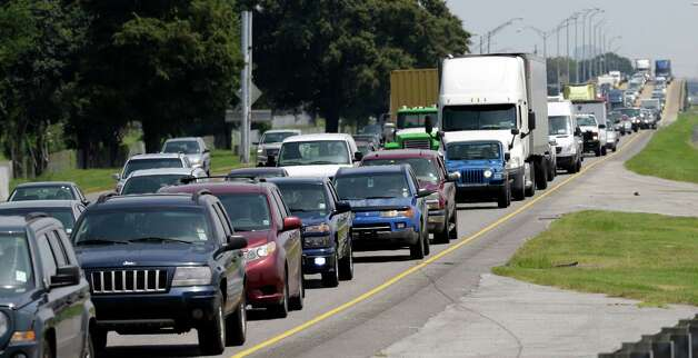 Traffic is stacked up along Interstate 10 heading West away from New Orleans Monday, Aug. 27, 2012 and Tropical Storm Isaac, which is churning it's way across the Gulf of Mexico. Republican elected officials from Louisiana and Mississippi scrapped Florida travel plans for the GOP's national convention, while some who had arrived in Tampa quickly turned around Monday and headed home to wait for the expected hurricane. Photo: David J. Phillip