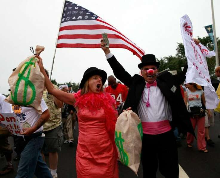 Activists demonstrate through downtown on Aug. 26, 2012, in St. Petersburg, Fla. (Tom Pennington / G