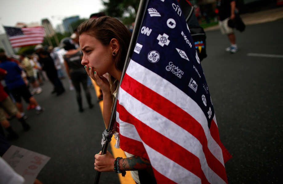 A woman holds a flag during a demonstration through downtown on Aug. 26, 2012, in St. Petersburg, Fla. (Tom Pennington / Getty Images)