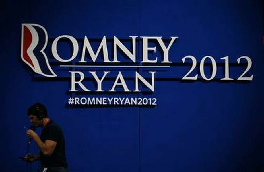 Romney-Ryan campaign sign is displayed inside of the Tampa Bay Times Forum at the Republican National Convention in Tampa, Fla., on Sunday, Aug. 26, 2012. (Jae C. Hong / AP Photo)