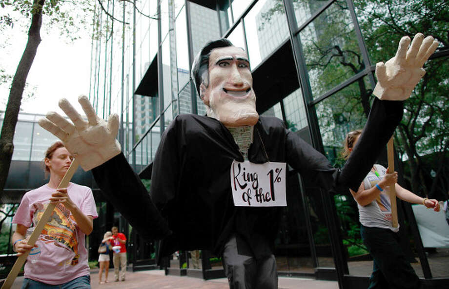 Protesters march through downtown with an effigy of Mitt Romney prior to the Republican National Convention in Tampa, Fla. (Tom Pennington / Getty Images)