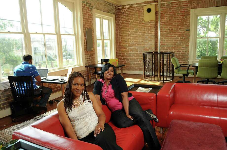Ky Willson, left, and Rosalind Wyatt opened CoInside in a refurbished fire station on Houston Avenue. Photo: Dave Rossman / © 2012 Dave Rossman