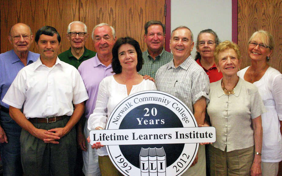 Lifetime Learner board members show off the 20th anniversary logo. From left to right front row: Mark Albertson, Morgan Corigan, Norman Glover, and Maxine Tobias. Back row: Charles Lamb, Bob Dubiel, Lee Larchevesque, Gary Lishnoff (president), Ann Bellow and Celia Maddox. Photo: Contributed Photo