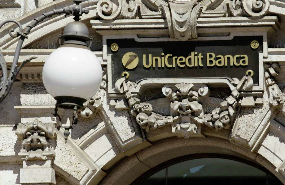 A view of the Unicredit bank headquarters in Milan, Italy, Monday, Aug. 27, 2012. Italy's UniCredit bank has confirmed that U.S. authorities are investigating its German unit for possibly breaking economic sanctions, but stopped short of naming Iran as the country it was dealing with. The Financial Times over the weekend reported that the probe was into suspected sanctions violations involving Iran, which is under international pressure because of its nuclear ambitions. UniCredit noted Monday that it first disclosed the existence of a U.S. probe in its 2011 financial statements and more recently in a capital increase prospectus, though it did not provide details.  (AP Photo/Antonio Calanni) Photo: Antonio Calanni / AP