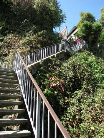 The Filbert Steps that ascend from the northeast waterfront to the top of Telegraph Hill are among the wonders of San Francisco, where city and landscape collide. (John King / SFC)