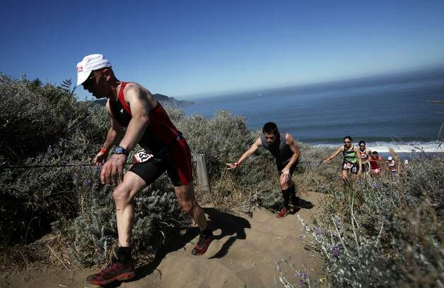 Participants in the Escape from Alcatraz Triathlon must climb the infamous Sand Ladder up from Baker Beach as part of the race's 8 mile run, but the rest of the year the steep stairs are accessible for anyone willing to make the climb.  (Sarah Rice / Special to The Chronicle)