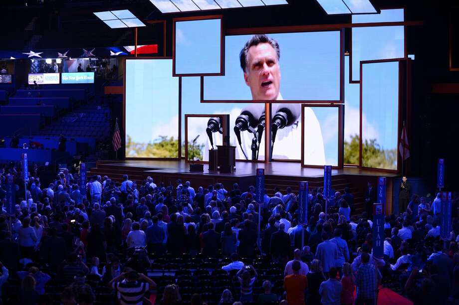Republican presidential candidate Mitt Romney is shown on a bank of video monitors on the opening day of the Republican National Convention on Monday, August 27, 2012, at the Tampa Bay Times Forum in Tampa, Florida. (Olivier Douliery/Abaca Press/MCT) (Olivier Douliery / McClatchy-Tribune News Service)