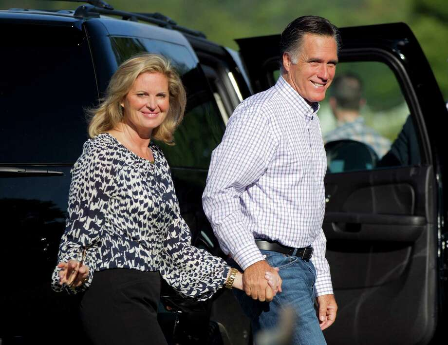 Mitt Romney is shown with his wife, Ann, in Wolfeboro, N.H., on Monday.  (AP Photo/Evan Vucci) Photo: Evan Vucci / AP