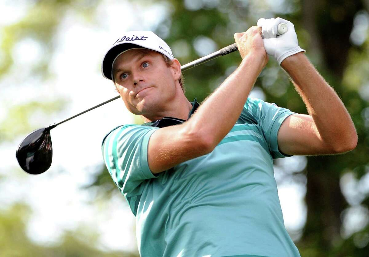 Nick Watney tees off on the 16th hole during the fourth round of The Barclays golf tournament at Bethpage State Park in Farmingdale, N.Y., Sunday, Aug. 26, 2012. Watney won the tournament. (AP Photo/Kathy Kmonicek)