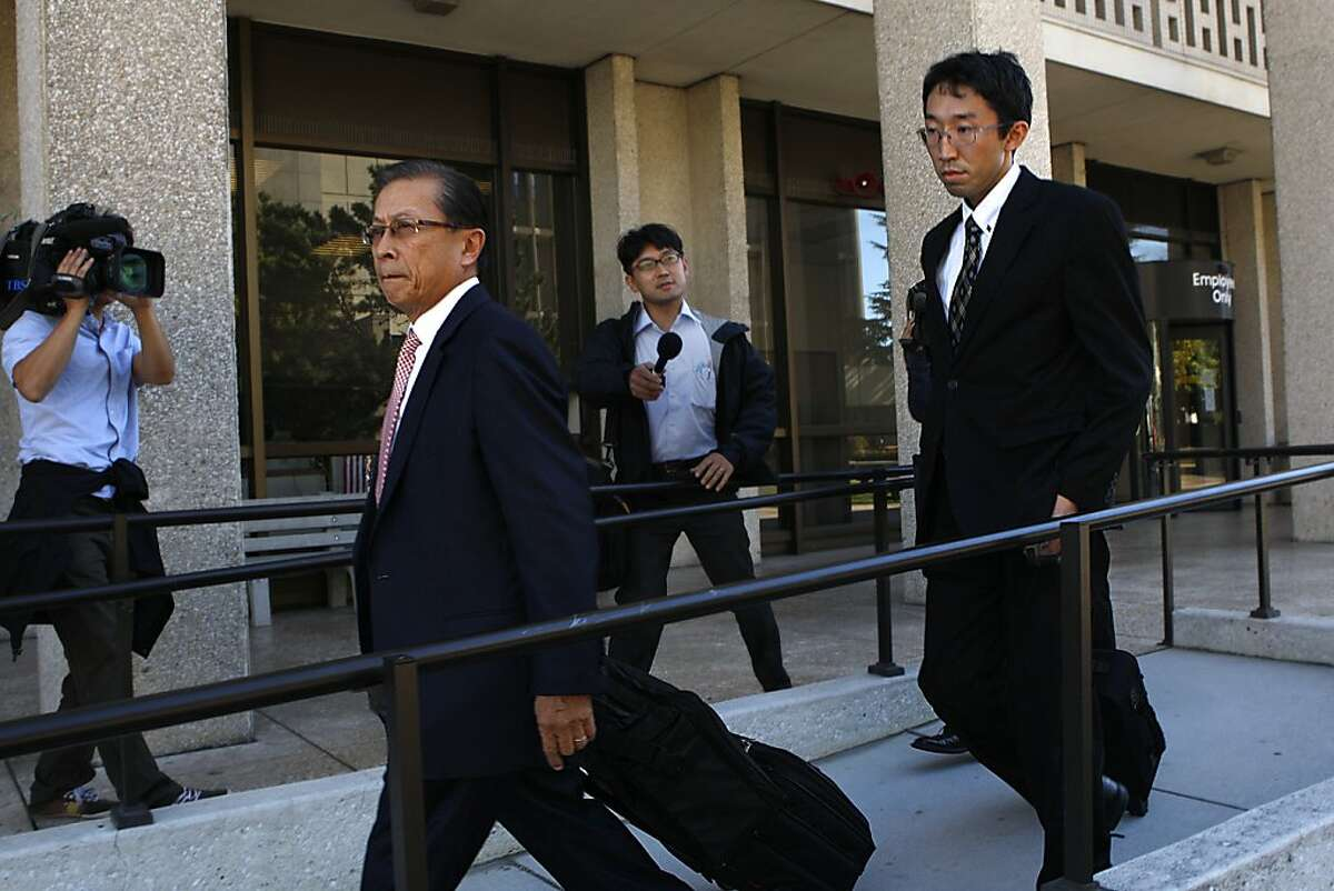 Attorney Garrick Sherman Lew (left) representing vice consul for Japan Yoshiaki Nagaya (right) accused of beating his bride of 18 months, leaving his hearing in Redwood City, Calif., on Monday, August 27, 2012.