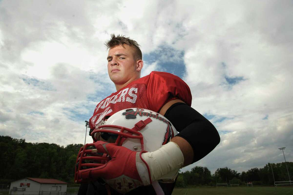 Mechanicville High School football linebacker, Nate Hatalsky, with his mohawk haircut, poses for a photograph on Monday, Aug. 27, 2012 in Mechanicville, NY. (Paul Buckowski / Times Union)